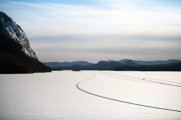 A view of the race course on the Yukon River. You can see some past competitors on the course. (Courtesy of Yukon Arctic Ultra)