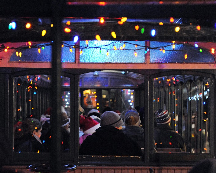 The Portage Flyer's historical open-air cars bedecked with lights make for an enchanting ride to see Santa (Muskoka Heritage Place)
