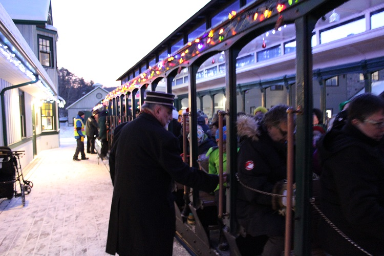 Helpful conductors ensure everyone is safely aboard before the train departs.