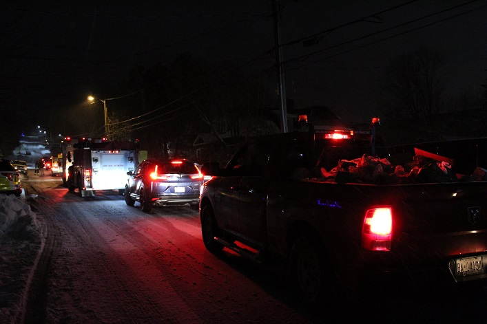 A long line of vehicles waited to offload their donations at the Salvation Army