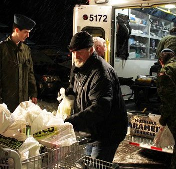Richard Cusson (centre) is one of hundreds of volunteers who help make the Project Porchlight food drive a success