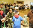 The Salvation Army gym was a hive of activity as volunteers sorted donations by type