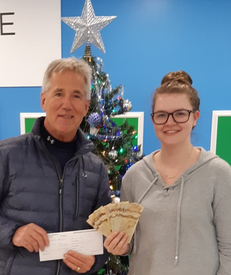 Katy Vowels (right, with Rob Saunders of the Rotary Club of Huntsville) won the Rotary bingo jackpot on December 3 by getting a full card in 52 numbers. The January 7, 2020 game has a guaranteed jackpot. (supplied)