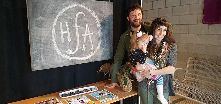 Dan Watson (back) and Christina Serra (holding Simone) in the HFA studio (Dawn Huddlestone)