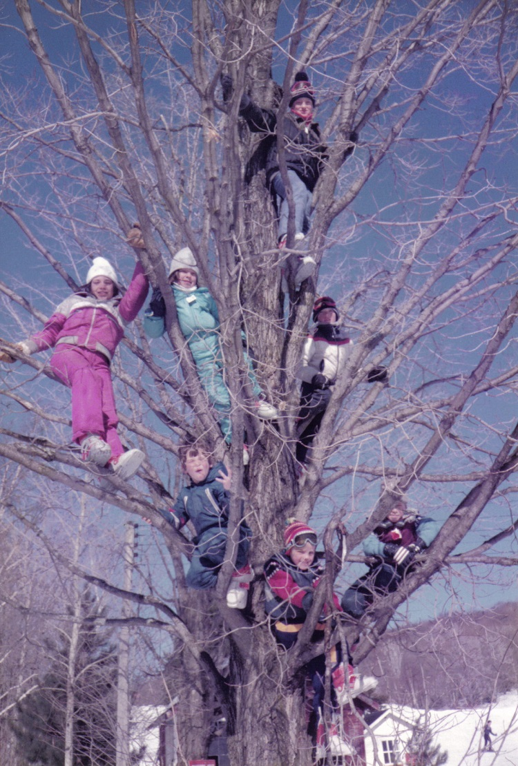 The Watson and Bernardo kids in the tree at Tally-Ho Winter Park in 1985...ski boots and all! (Courtesy of Martha Briggs Watson)