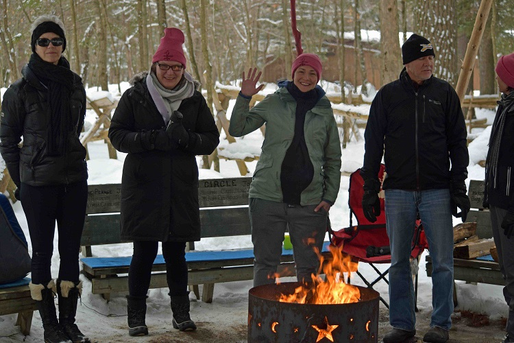 Jo-Athlon participants gathered around the fire to warm up (Cheyenne Wood)
