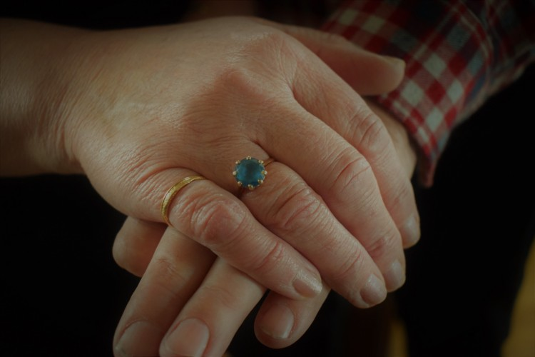 Art gave Heather that beautiful blue ring on her 14th birthday and she's never taken it off. It reminds her of his eyes, she says. (Laura MacLean)