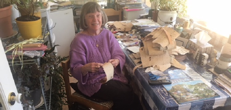 Frances Balodis sorting the birch bark she uses for her cards (supplied)