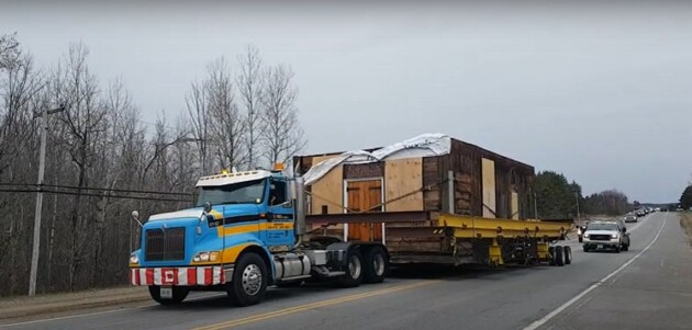 Part of Grassmere Church as it was hauled along Hwy 60 to Hillside Farm (Dawn Huddlestone)