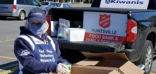 A Kiwanis Club of Huntsville Muskoka member collects donations at Metro on May 13, 2020 (Kiwanis Club of Huntsville Muskoka / Facebook)