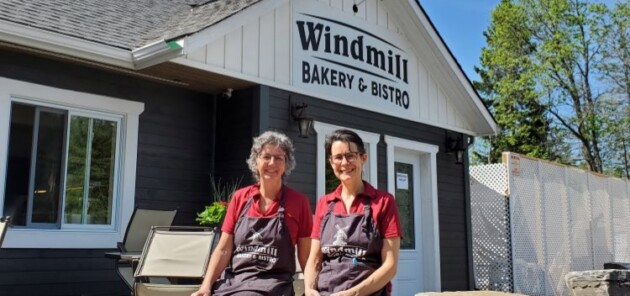 Windmill Bakery and Bistro employee Barbara Williams-Laning (left) and co-owner Grace Willows pause for a photo during a busy morning.
