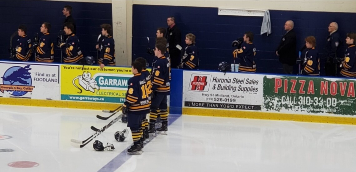 Marc Gagnon (back, second from left) on the bench with the Otters (Deb Reynolds)