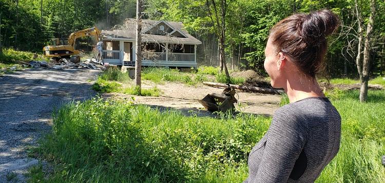 Bridgette Austin watches her mould-filled home be demolished (Mandi Hargrave)