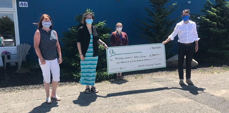 Stay at Home Gala organizer Beth Goodhew (left) and MCF chair Daniel Bradbury (right) present a cheque for $9,600 to Jennifer Bell of Muskoka Women's Advocacy Group. (supplied)