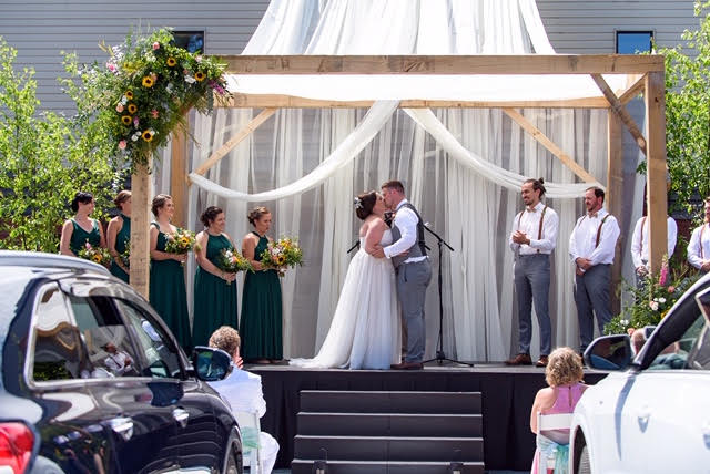 Dana and Colin Greenleaf seal their vows with a kiss. (Kelly Holinshead)