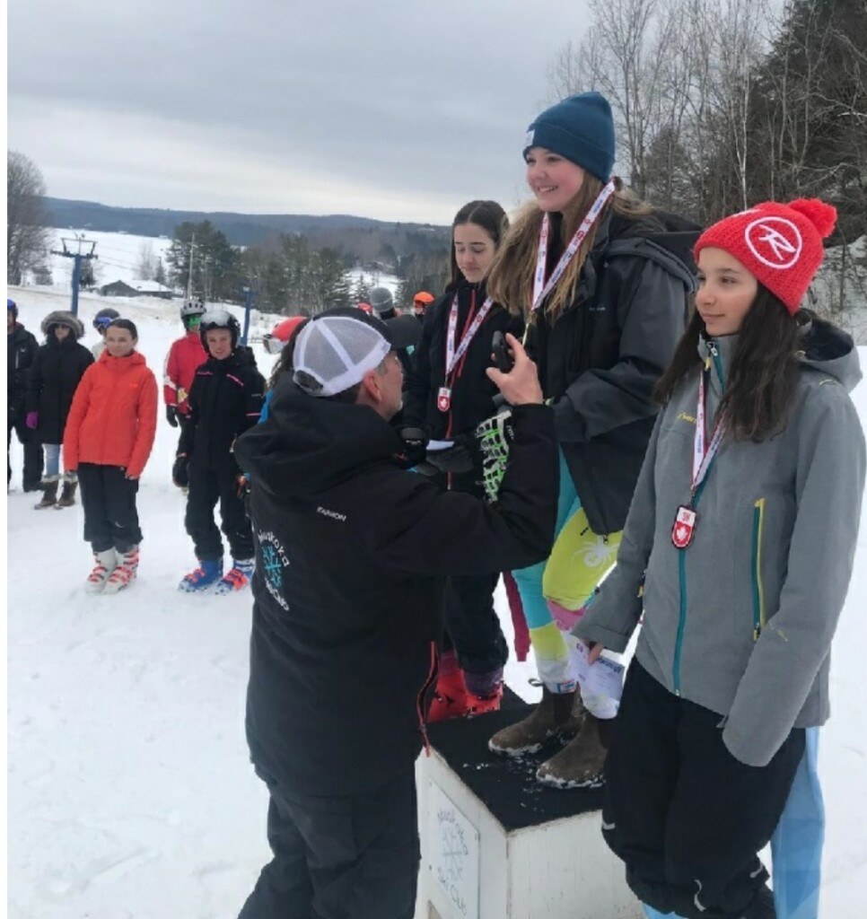 Abby Costello at her last race of the regular 2019-2020 ski season. Bruce Howell, MSC director of alpine experience and head coach, presented her first-place medal. It was a home race which made it very special. (supplied)