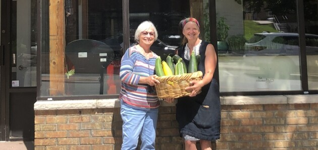 Muskoka North Good Food Co-op board chair Susan McGrath (left) and general manager Kelli Ebbs in front of the co-op's new location on Main Street (Sydney Allan)